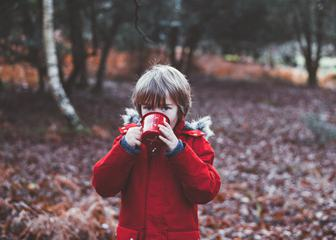 Little Cute Boy Drinks from a Metal Cup in the Autumn Park