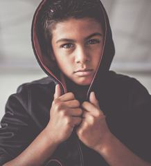 Portrait of Boy Looking at Camera with Serious Facial Expression