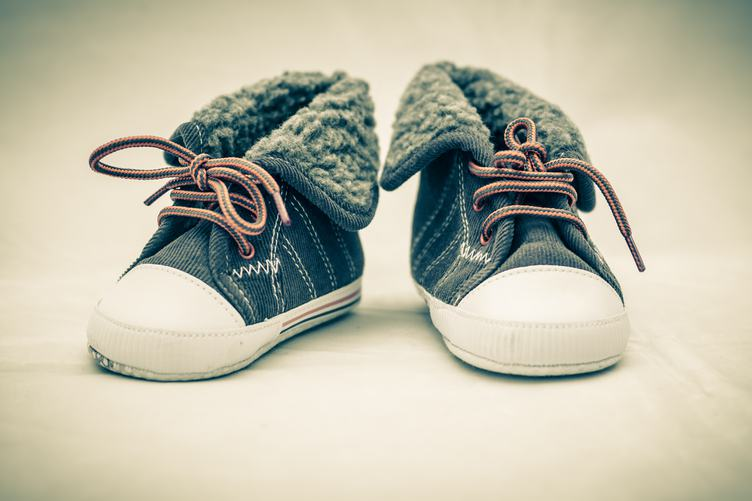 Pair of Brown Baby Sneakers with Orange Shoelace