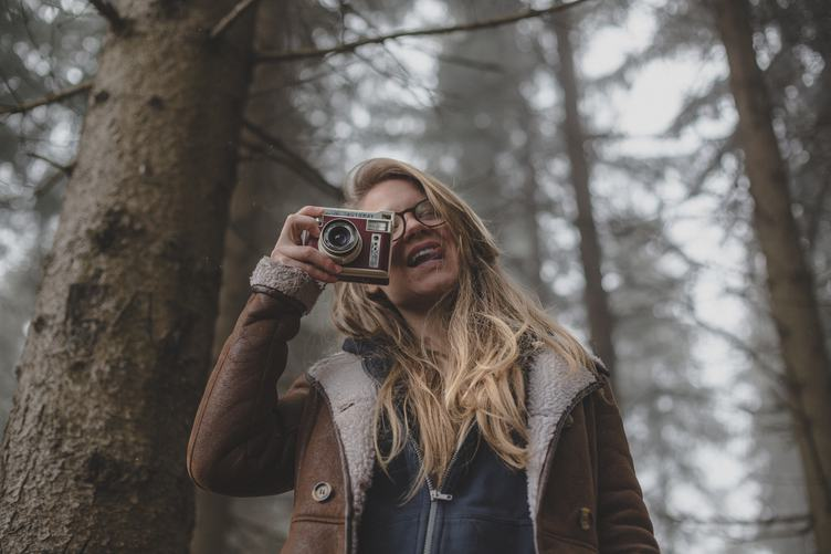 Woman in the Forest Hand Holding Retro Camera