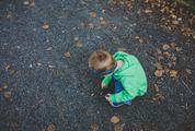 A Little Boy Playing Outside