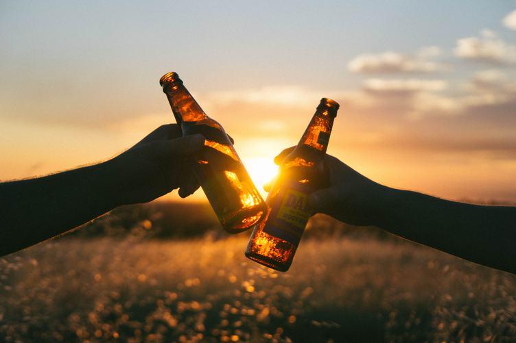 Cheers, Hands Toasting with Bottles of Beer