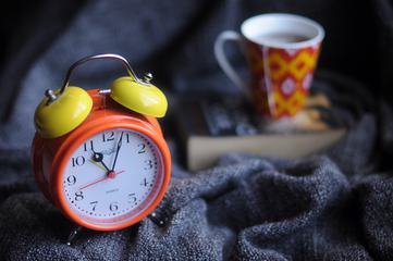 Classic Retro Alarm Clock on Dark Blanket