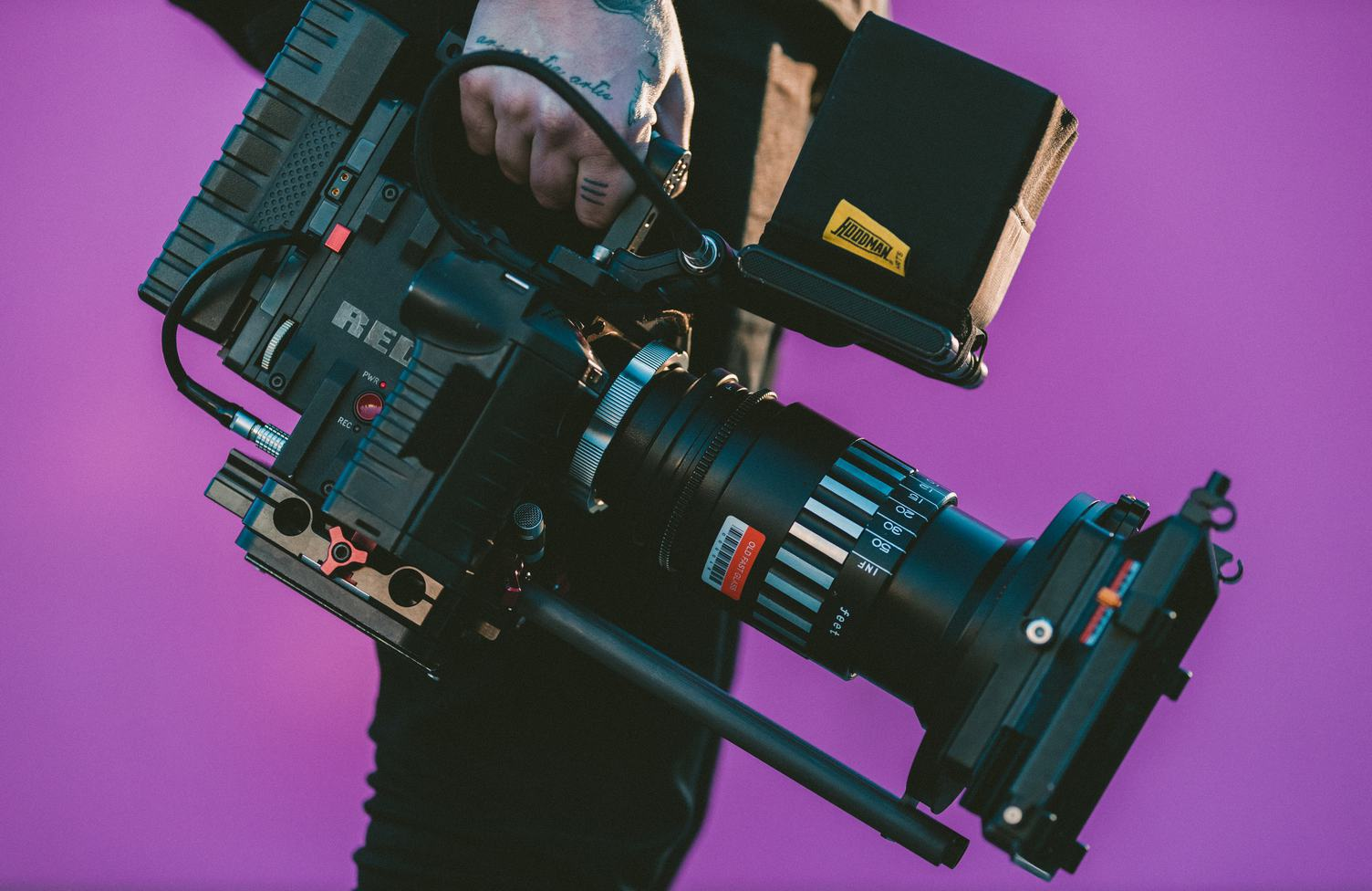 Video Camera Operator Carrying His Professional Equipment