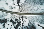 Aerial Shot of Snow Covered Road Curve