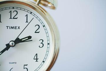 Old Alarm Clock on White Background Closeup