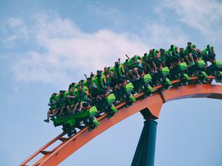 Roller Coaster Ride Against Blue Sky