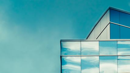 Sky is Reflected in the Glass of a Modern Building