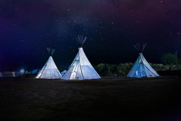 Three Tipi Tents at Night
