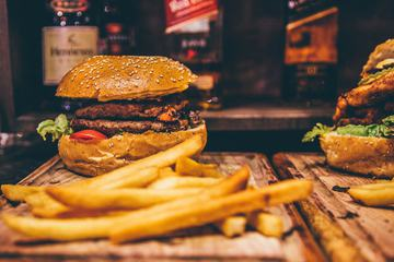 Hamburger and French Fries on Wood