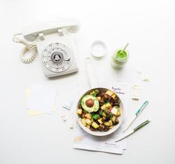 Food and Old Phone on White Table