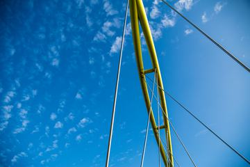 View of Yellow Bridge Elements against a Blue Sky