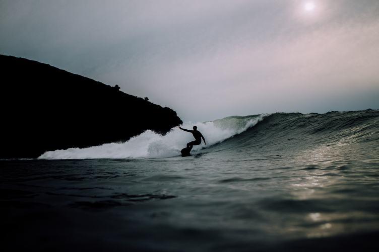Silhouette Man Surfing Wave