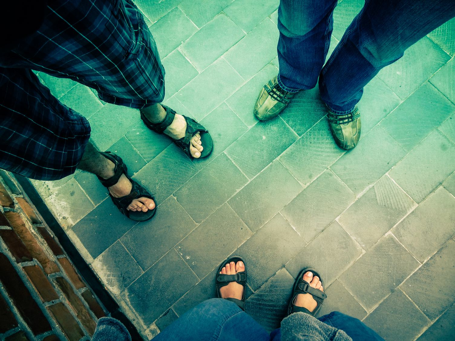 Foot and Legs of Three People Seen from above