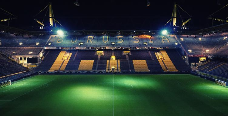 Empty Night Football Stadium in the Lights