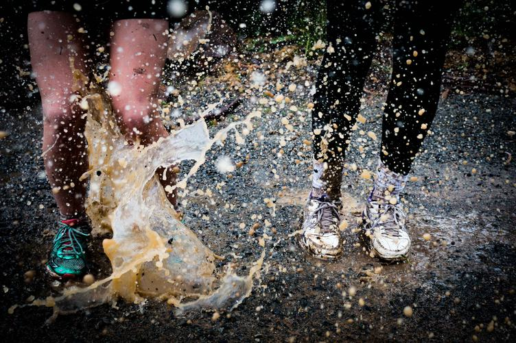Race Runners Legs in Mud and Water