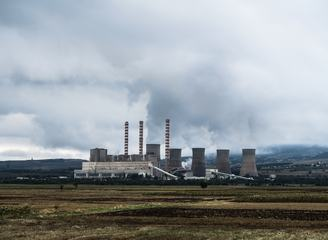 View of Coal Power Plant with Several Chimneys and Huge Fumes