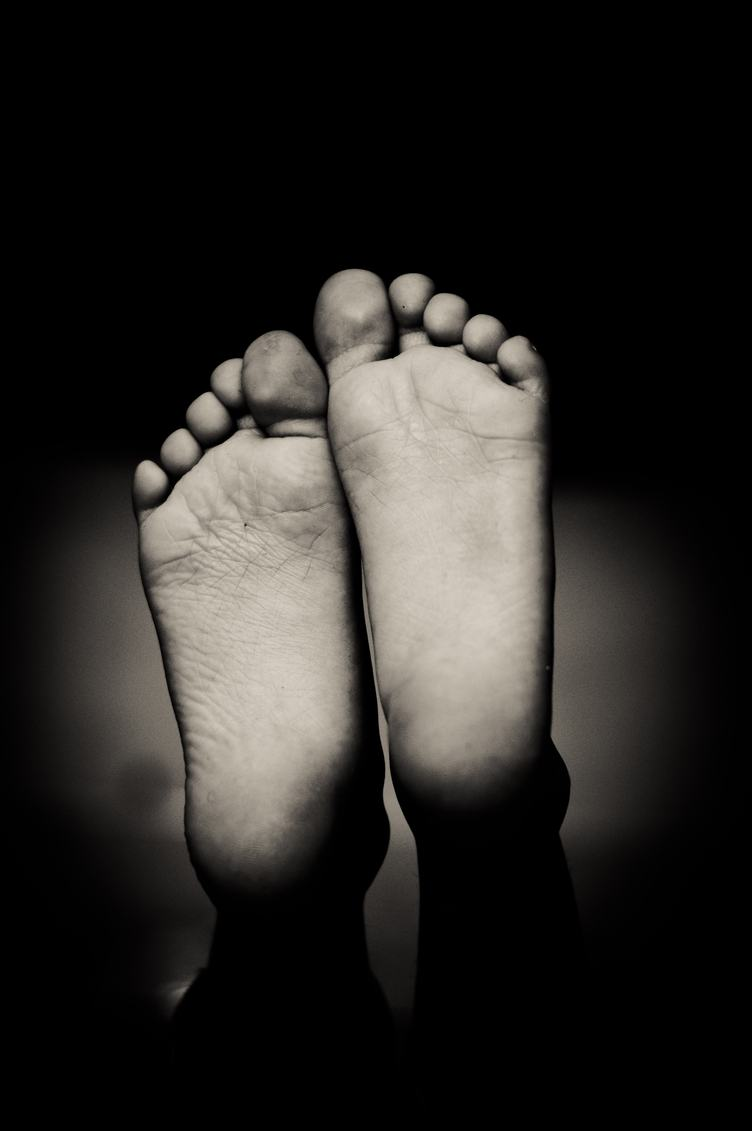 Closeup of Barefoot on Black Background