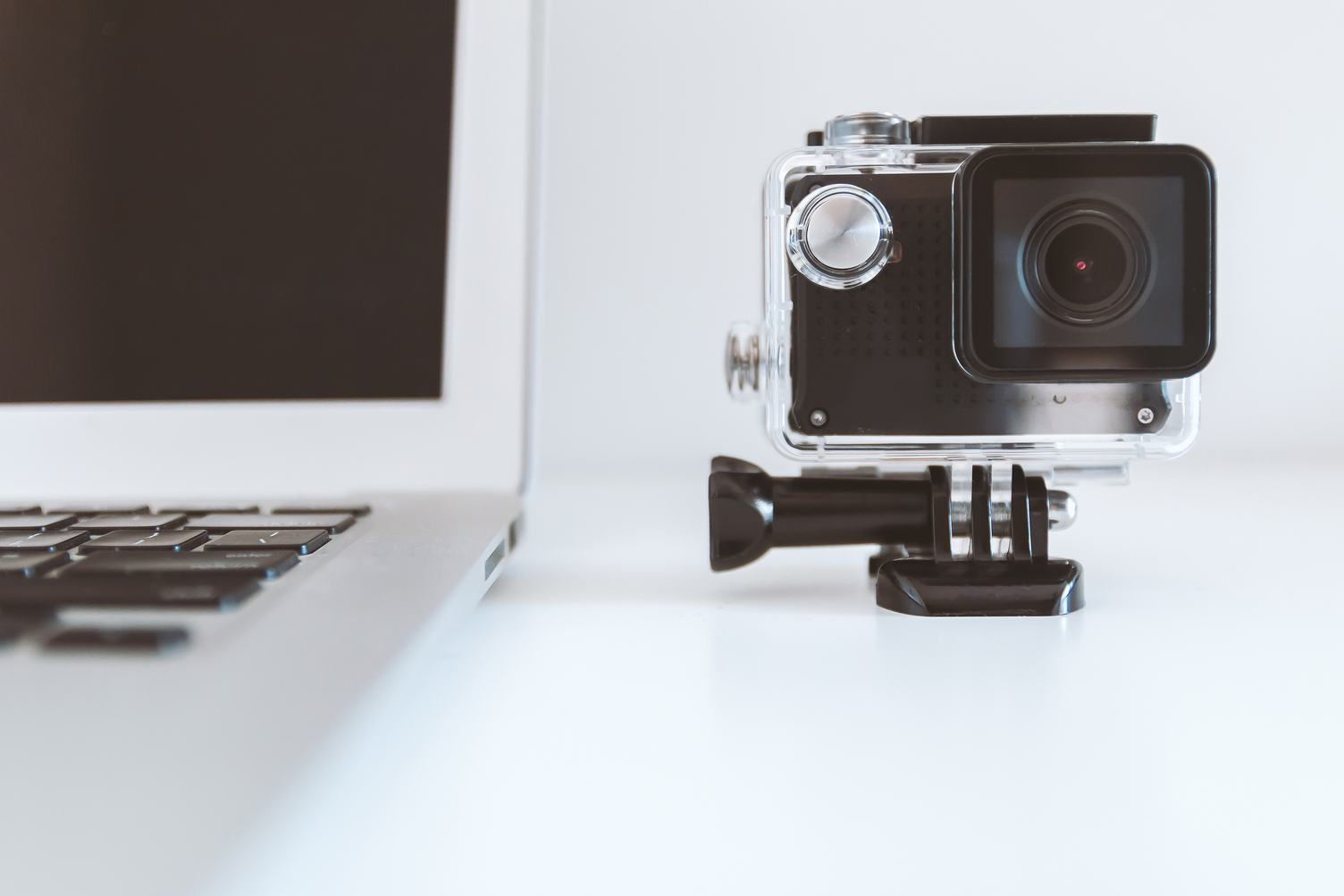 Close up of MacBook and camera GoPro on white Background