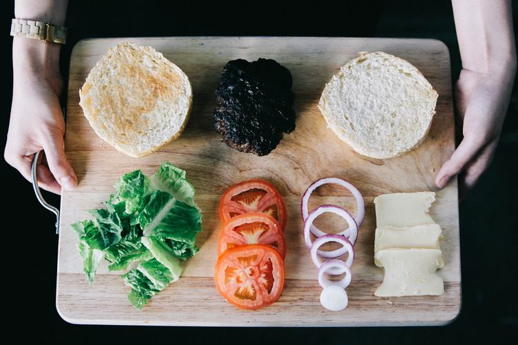 Delicious Fresh Homemade Burger Ingredients on a Wooden Tray