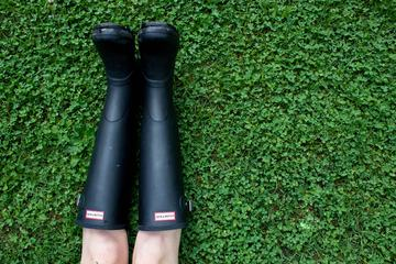 Person Wearing Wellington Boots Lying on Grass