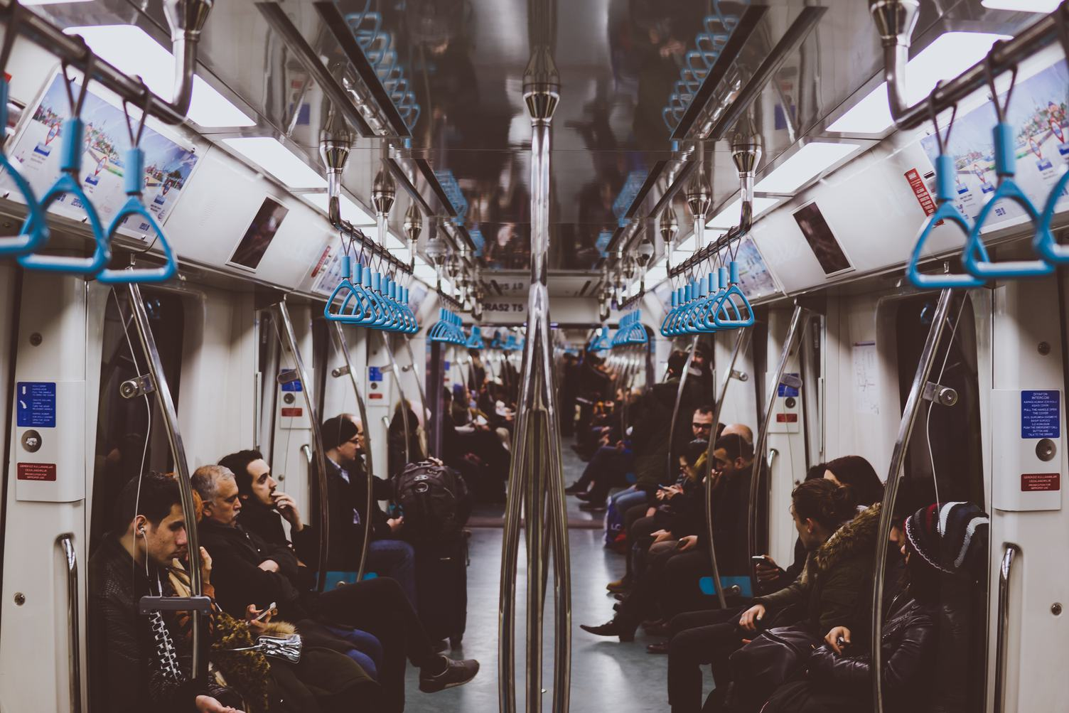 View from Inside a Subway with Passengers