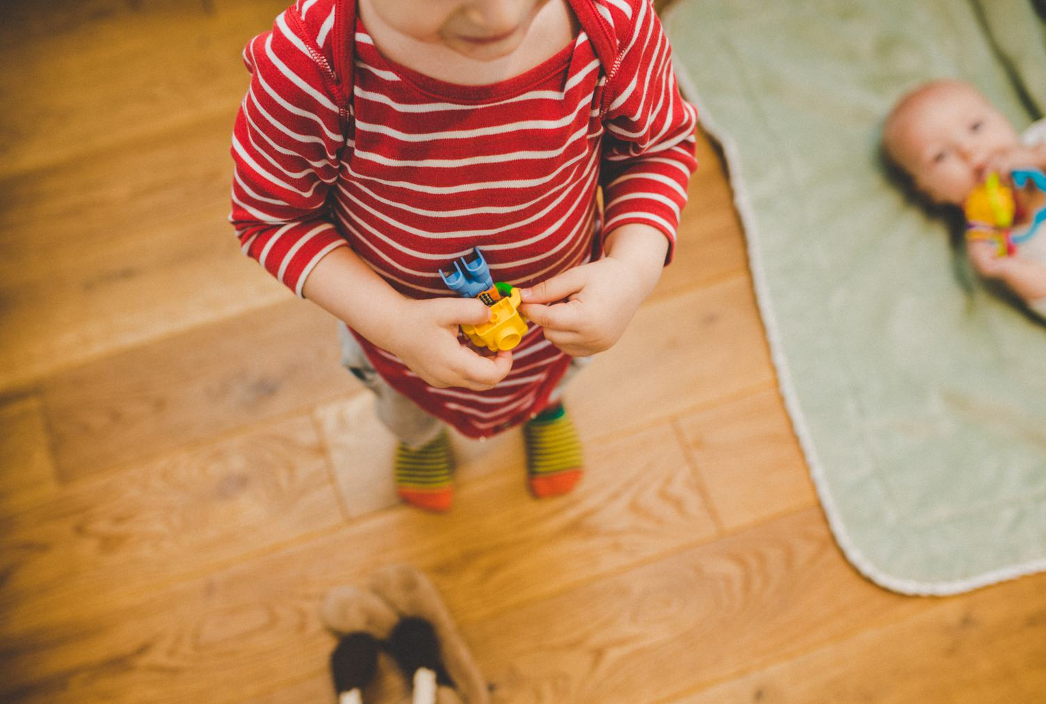 Two Years Old Boy Playing Lego Bricks