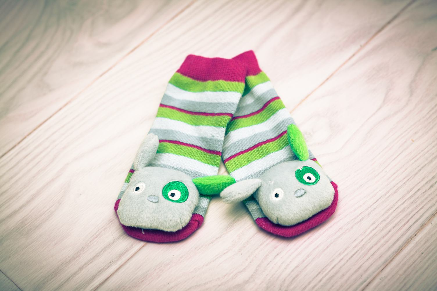 Baby Striped Socks on White Wooden Floor