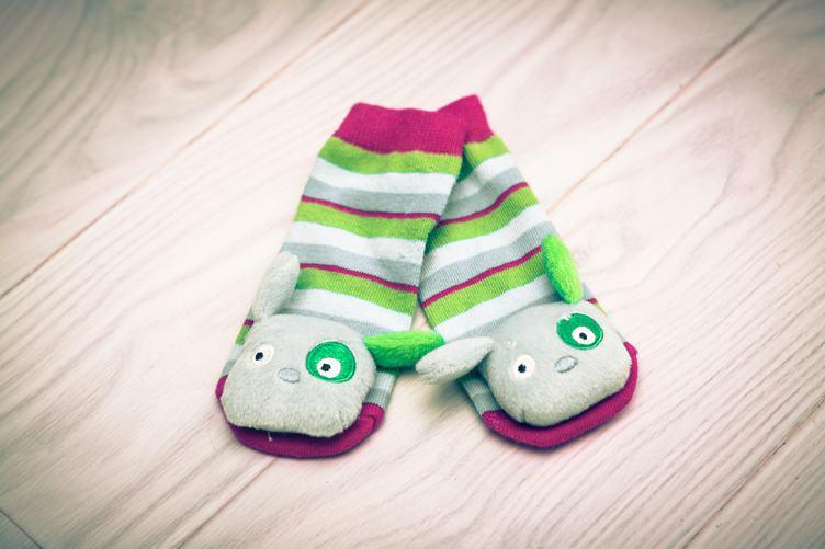 Baby Striped Socks on White Wooden Floor