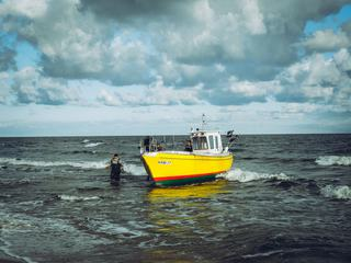 Yellow Fishing Boat Returns to the Shore