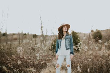 Brunette Woman Standing on a Meadow