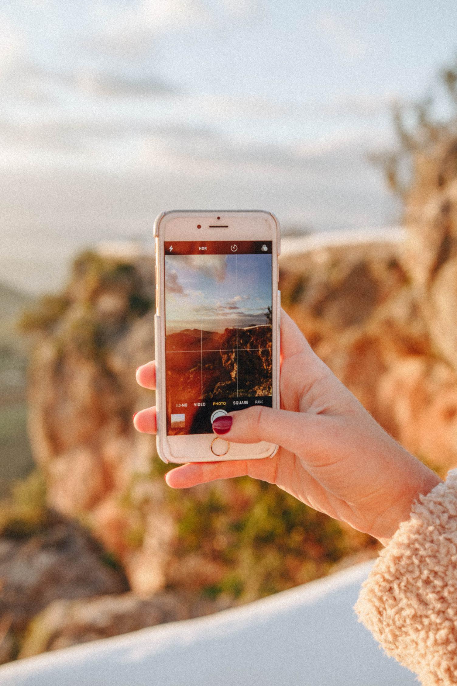 Woman Taking Photo of Mountain View