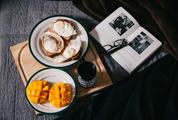 Book and Breakfast on the Wood Tray in Bed