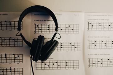 Music Sheets and Headphones on Table