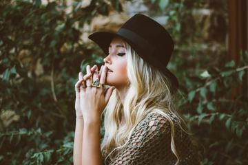 Beautiful Blonde Wearing Black Hat with Closed Eyes
