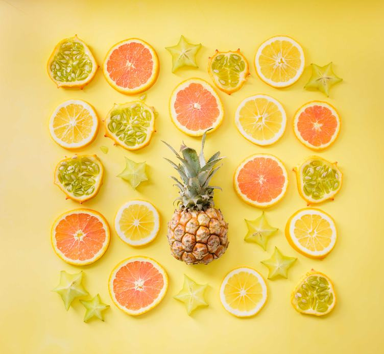 Sliced Fruits Composition On Yellow Background