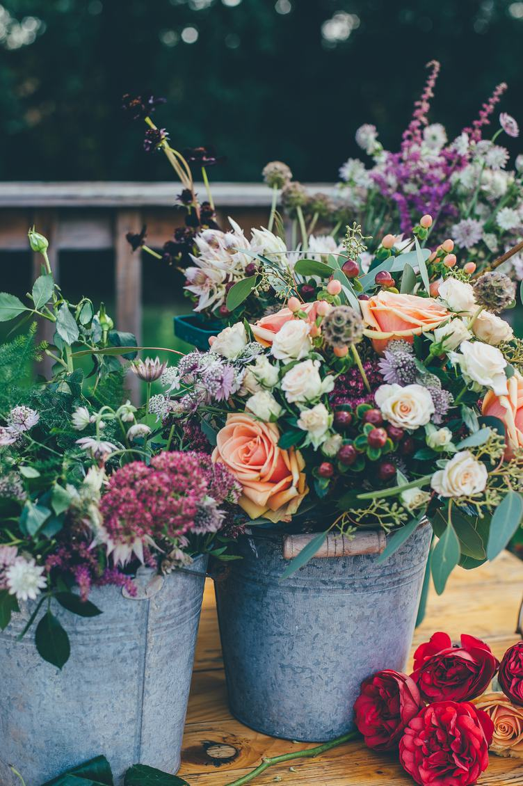 Beautiful Flower Composition in Metal Bucket Outside