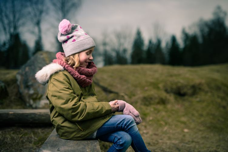Child Girl in Warm Jacket and Hat