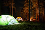 Camping in Forest with Tent Light and Bonfire