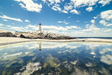 A Lighthouse Reflection with Calm Waters