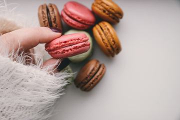 Woman Holding Colorful Delicious Macaroons
