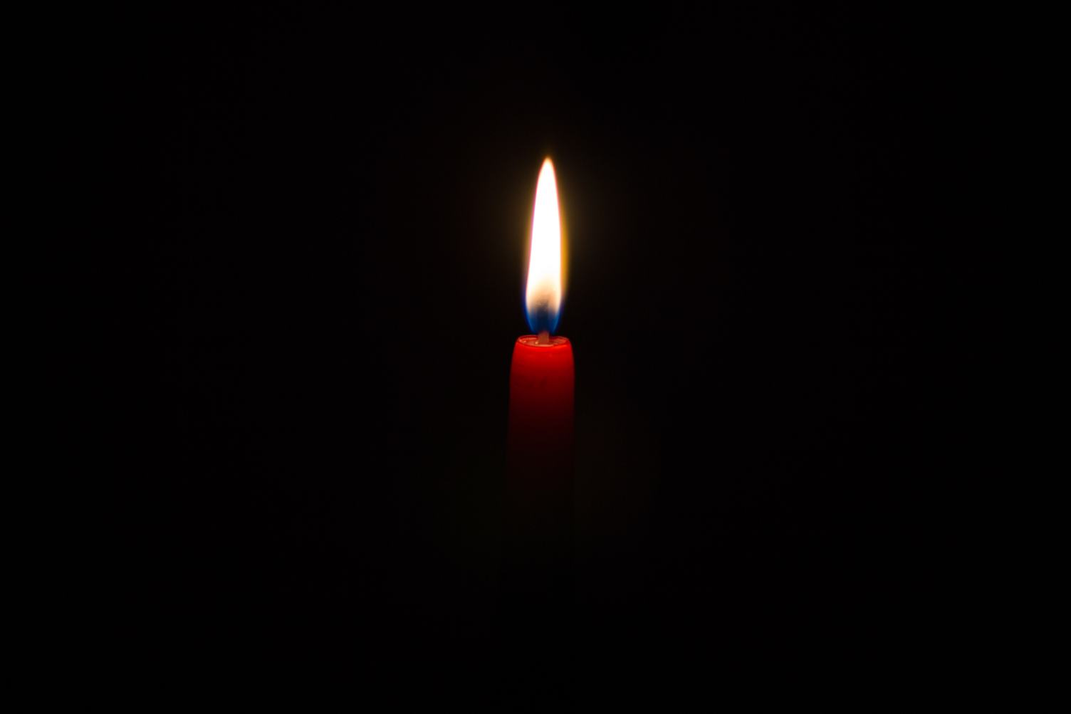 Red Candle against Black Background