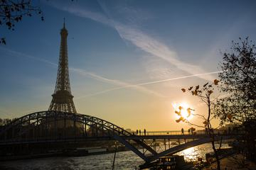Sunset over Seine in Paris with Eiffel Tower in Autumn Time