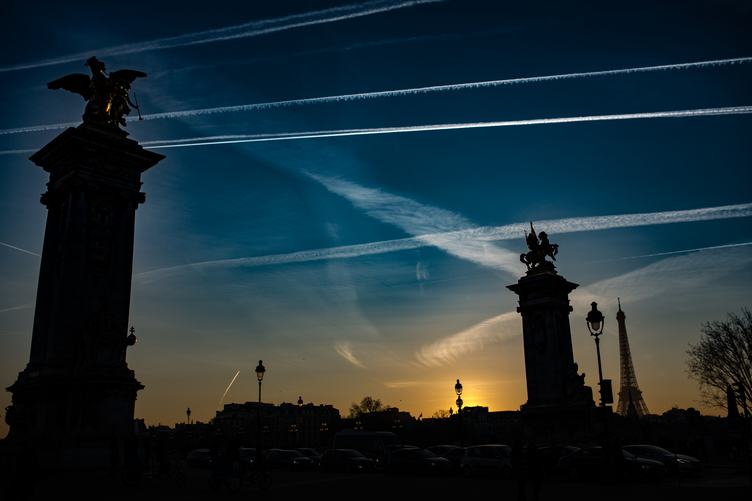 Silhouette of the Eiffel Tower and Pont Alexandre III in the Evening in Paris, France