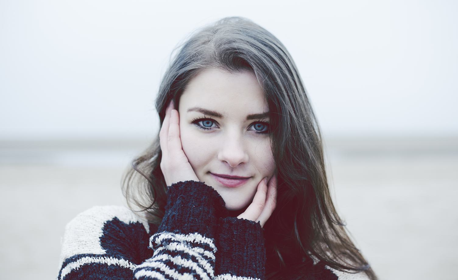 Beautiful Young Woman in a Black and White Knitted Sweater