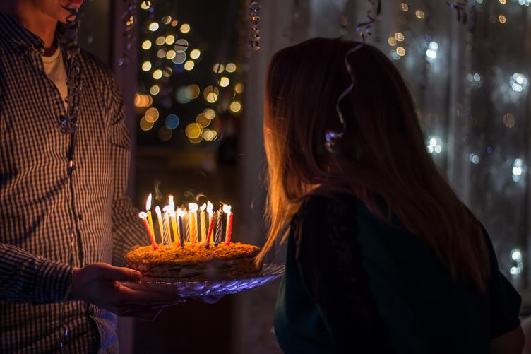 Birthday Man Holding a Cake with Candles for his Girlfriend