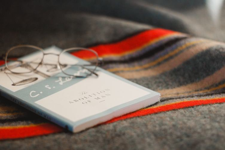Glasses and Book on the Blanket