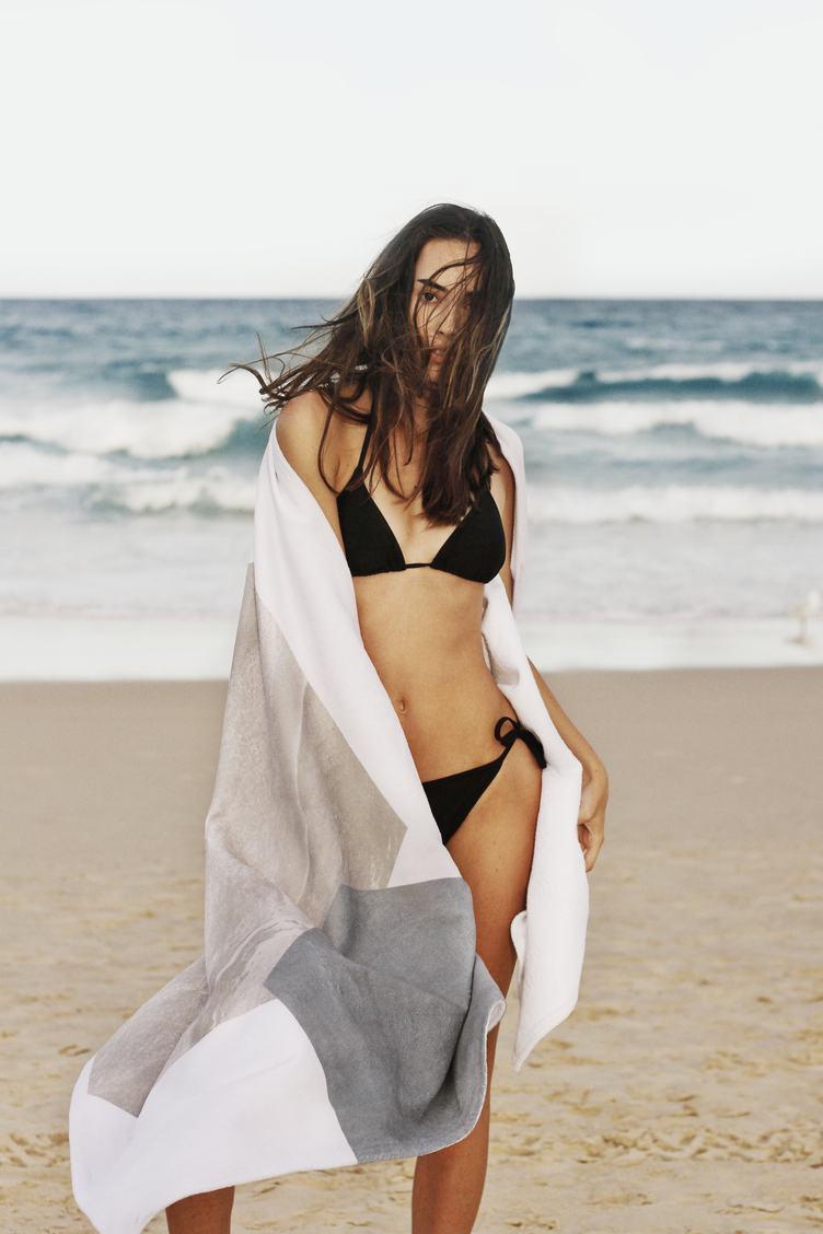 Beautiful Young Woman in Black Bikini Posing on the Beach