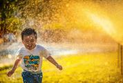 Happy Boy Running, Water Spray