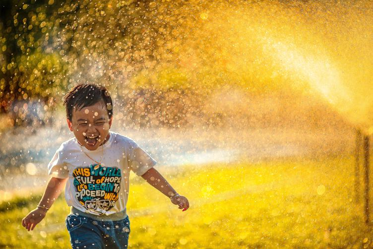 Happy Boy Running, Water Spray